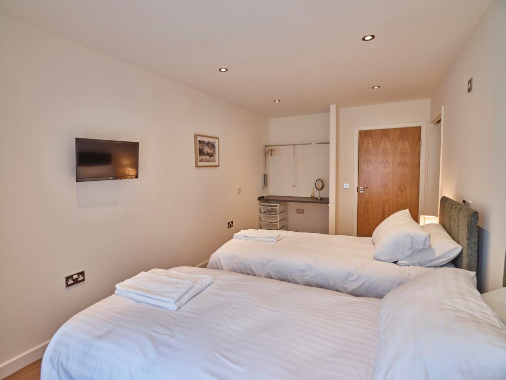 Sapphire room showing twin beds and dressing area