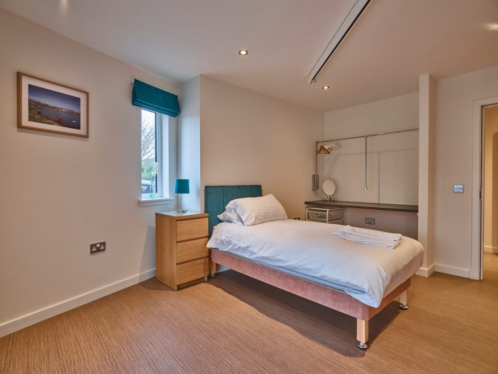 Opal bedroom showing dressing area and ceiling tracking hoist