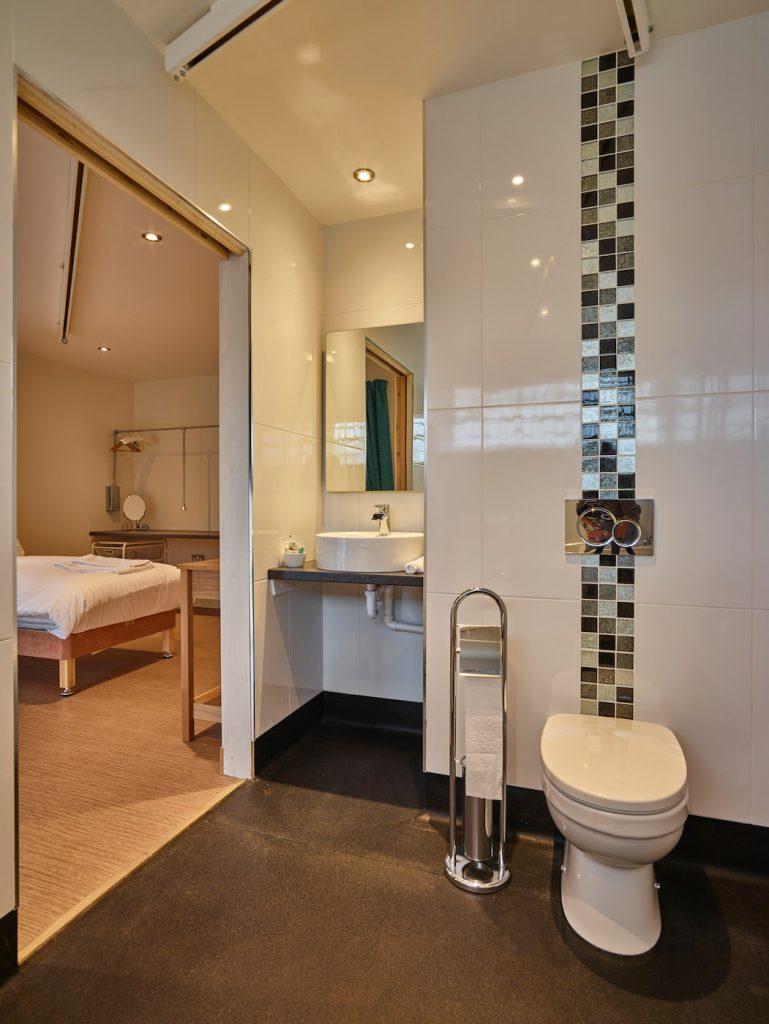 Opal bathroom showing ceiling tracking hoist