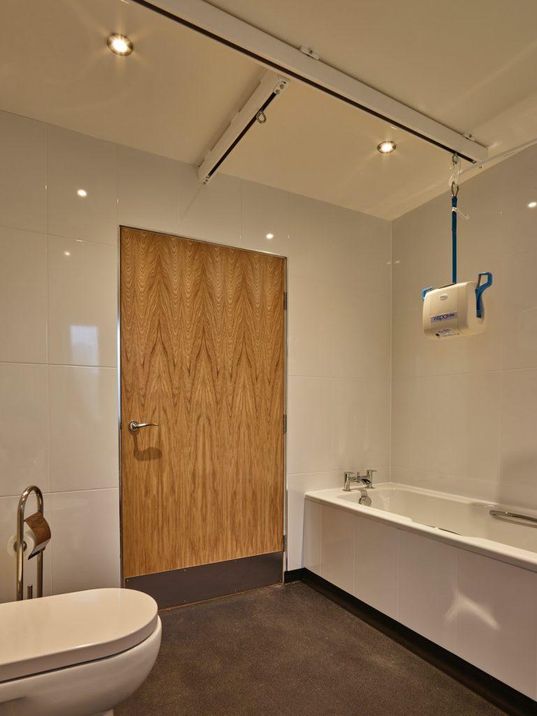 Ruby bathroom showing ceiling tracking hoist