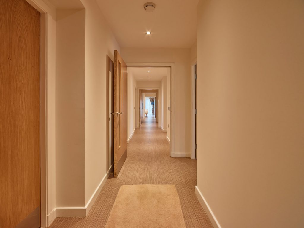 View showing a long, wheelchair accessible corridor